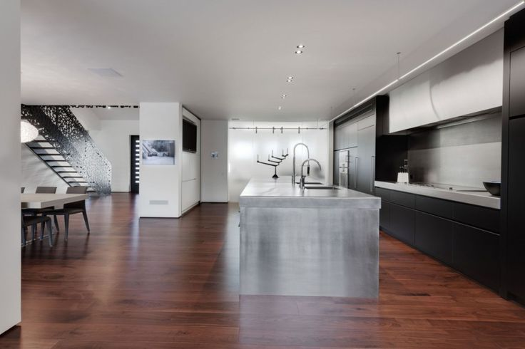Interior:Excellent Stainless Steel Kitchen Islands With Kitchen Faucets Sink Stovewith White Wall Laminate Floor Also Black Kitchen Cabinets Also Adorable Black Polka Dots Staircase Of Iron Lace Modern Mansion Style In Canada Modern Mansion Style with Adorable Black Polka Dots Staircase in Canada