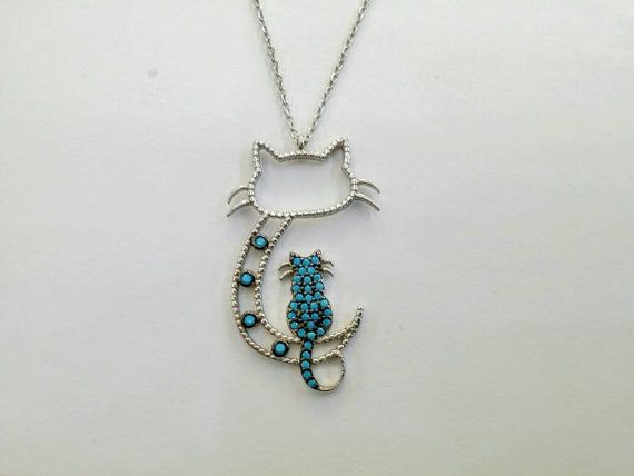 Check out this item in my Etsy shop https://www.etsy.com/uk/listing/490357308/cat-in-a-cat-silver-necklace-with