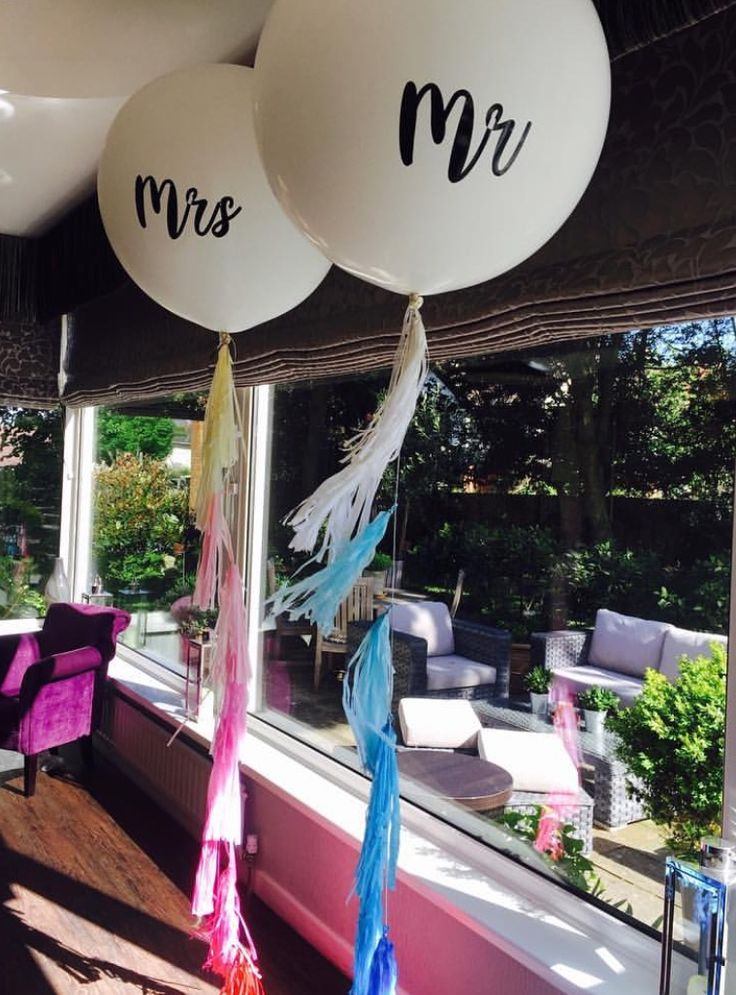 White giant balloons personalised with Mr and Mrs and pink and blue ombré tassel tails - wedding balloons at Cliff House Hotel, Bournemouth