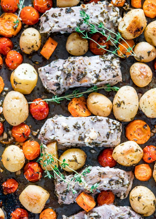 Greek Pork Loin Ribs and Potatoes Sheet Pan Dinner - a super simple dinner with pork loin ribs, potatoes, carrots and tomatoes with a very delicious marinade made with lots of garlic and herbs.