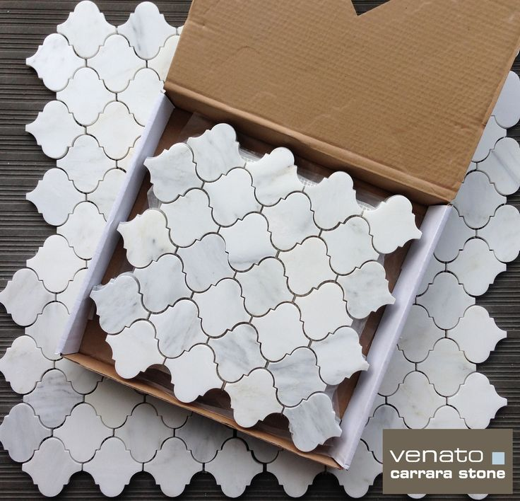 Carrara Venato Arabesque Tile.  White based marble cut into Moroccan shapes for an incredible look on Floors or Walls for $16.95 a square foot.
