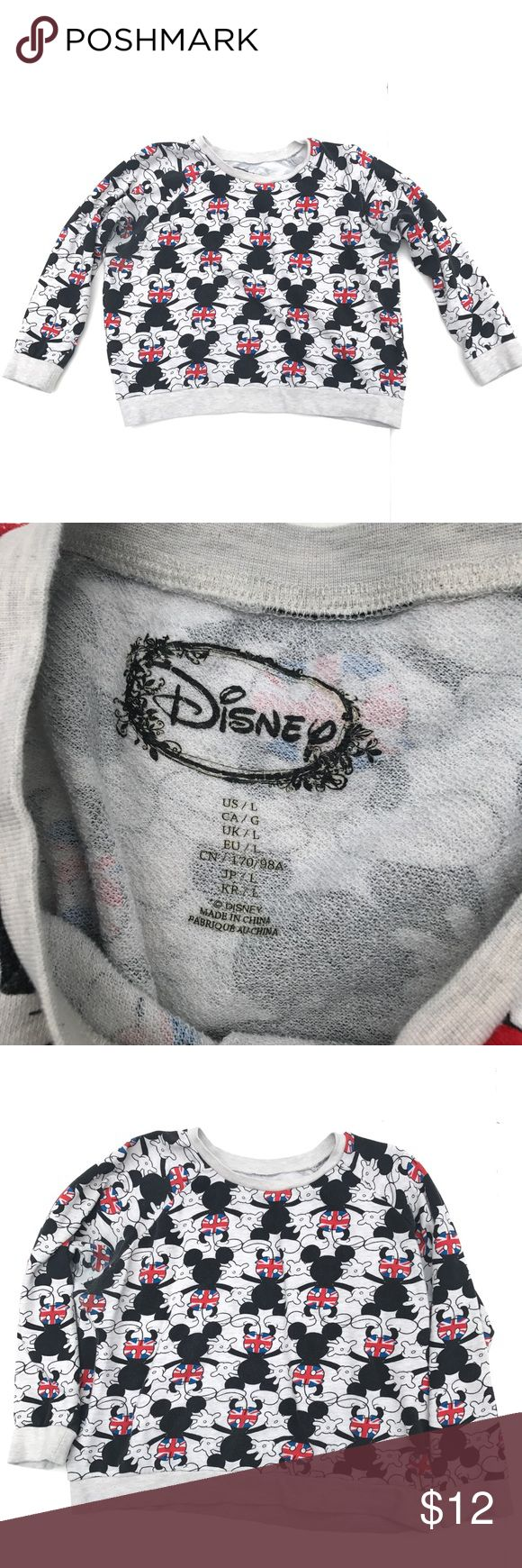 """British Mickey Mouse Sweatshirt, Junior Size Large Gently worn British Mickey Mouse shirt in junior size large.         Measurements - 23"""" armpit to armpit 19"""" total length from back of collar 22"""" top collar to bottom sleeve This shirt has shorter sleeves on me. I have to push them up to the elbows. Unless you have short arms they will probably need to be pushed up. Light pilling and some slight wash wear, especially near side armpit areas. Price reflects slight wear. Thanks for looking…"""