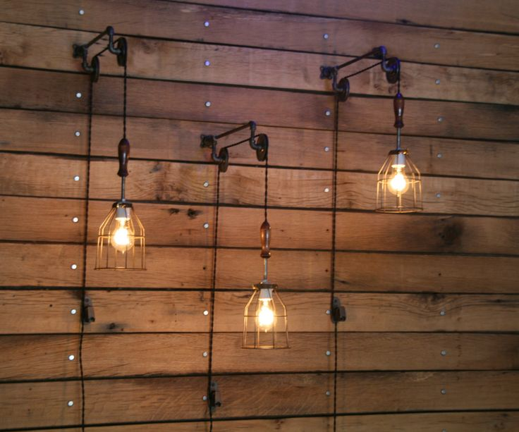 Pulley Wall mount with Industrial cage Light and Wooden Handle - ON SALE - Pay 118.40 with Coupon Code PULLEY20 by IndustrialRewind on Etsy https://www.etsy.com/listing/152726128/pulley-wall-mount-with-industrial-cage