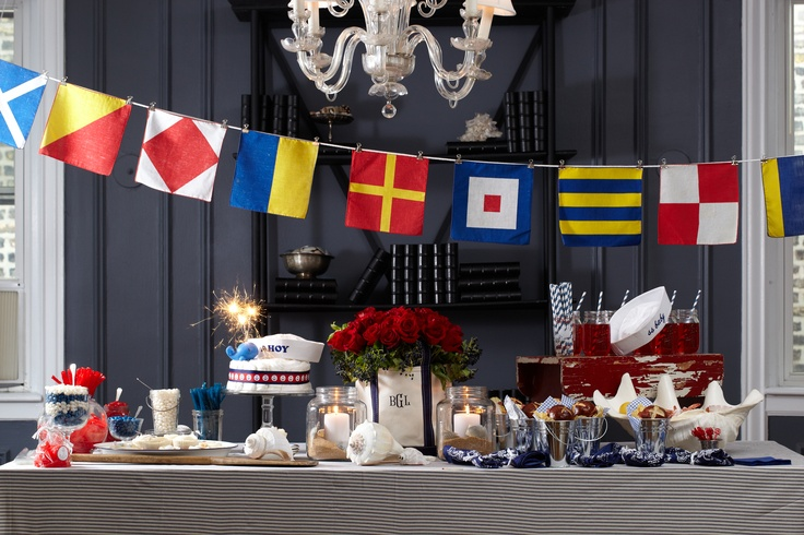 Anchors away! Get inspired by a treasure trove of nautical novelties for your baby shower, including candles with sand and seashells, a navy blue initialed tote, anchor-themed accents, maritime flags, sea-themed treats, a diaper cake using HUGGIES® Pure & Natural Diapers and more.