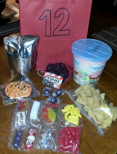 Hunger Games,  Catching Fire snack pack / treat bag.  Chocolate coal ( district 12 ) Cotton candy ( Effie's colorful hair ) Bugles ( cornucopia ) Trident gum ( Finnick ) Sugar cubes ( Finnick ) Gummie fish ( Arena ) Banana runts ( arena monkeys ) Candy roses ( President Snow ) Yogurt covered peanut ( the pearl ) 2 Kisses ( Gail & Peeta ) Angry birds gummies ( Jabberjays ) Grape jaw breakers ( Nightlock ) Frosted cookie ( Melark bakery ) Roarin Waters ( Arena ocean )