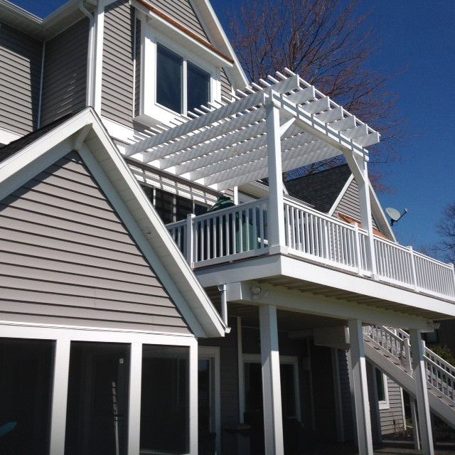 Elevated Deck With A Pergola Attached To The Home Nicely