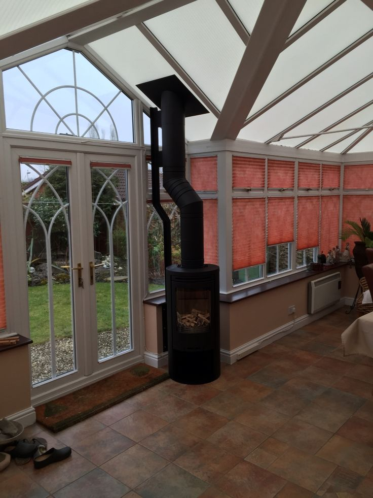 Contura 510 stove with custom made offset bracket and using Poujoulat flue