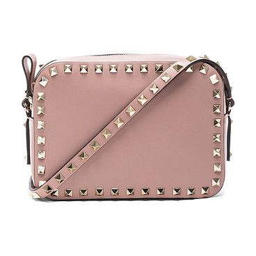Rockstud Crossbody Bag by Valentino. Genuine leather with canvas lining and gold-tone hardware. Made in Italy. Measures approx 7.5W x 5.25H x 2.5D. Adjustable shoulder strap. Zip top closure. Interior pocket and zip pocket. Metallic pyramid stud detail along edges and shoul... #valentino #bags