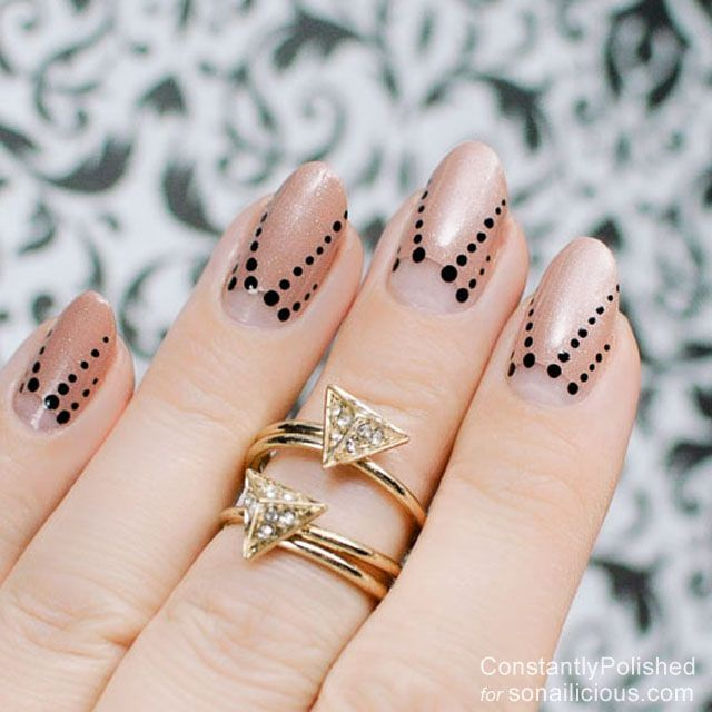 Negative space polka dot nails:  || 8 Manicure Ideas for First Date: http://sonailicious.com/10-easy-manicure-ideas-first-date/