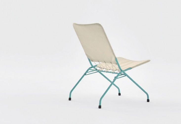 How cute is this Above: The 660 Folding Chair from Adico has a metal frame and canvas upholstery connected with raw cotton cord. The base is available in black, white, red, mustard, off white, sky blue, turquoise, and taupe; £158 ($231.18) from Twenty Twenty-One.