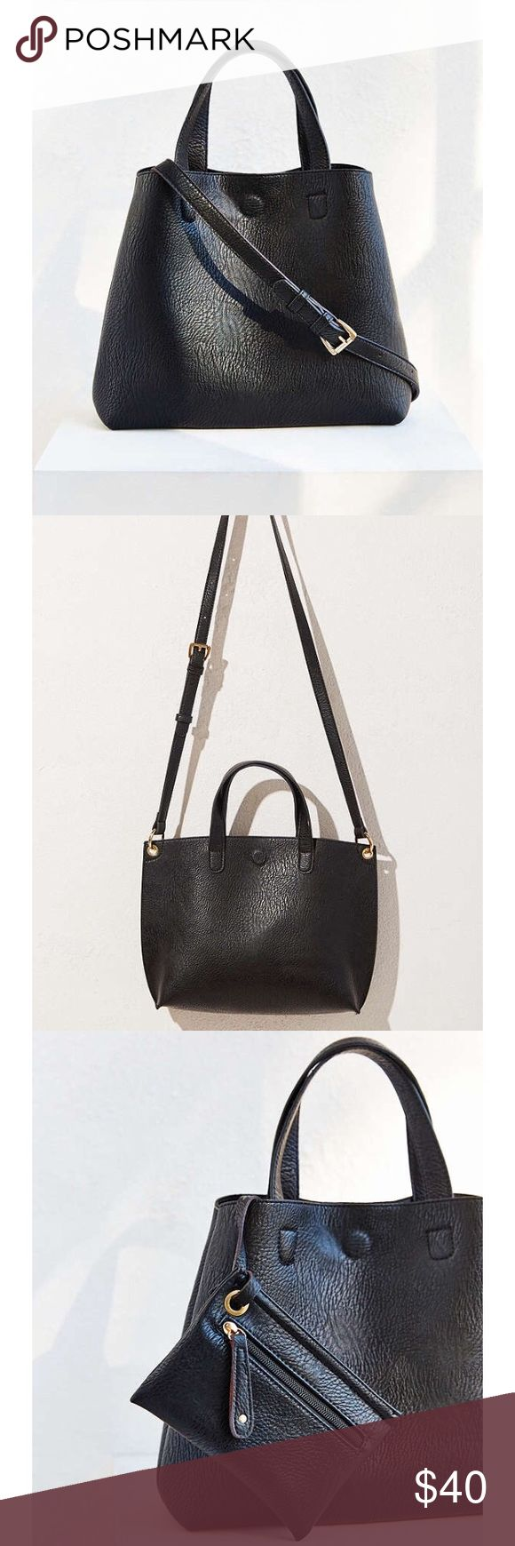 """Mini Reversible Faux Leather Tote Bag """"Mini reversible tote in full-grain faux leather topped with carry handles + a long, adjustable strap that detaches for carrying options. Includes a clip-on zip pouch topped with leather pulls at the interior, perfect for use as a matching wallet. Finished with a magnetic snap closure.  Faux Leather OS No flaws"""" Urban Outfitters Bags"""