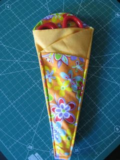 This is a great little project which would look lovely in a plain and printed fat quarter fabric.  Great for keeping your scissors safe and handy!