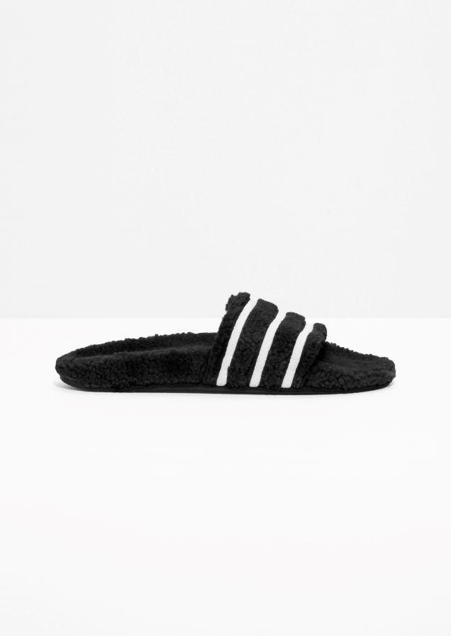 3f84df46a837   Other Stories image 1 of adidas Adilette Slides in Black