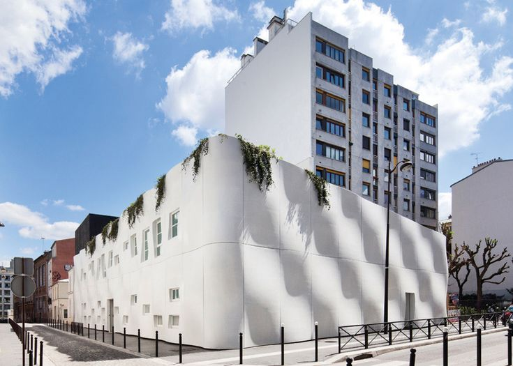 French architectsECDMhave completed a nursery in Paris with rippling concrete walls (+ slideshow). The billowing curves of the facade were created using a series of prefabricated panels, which wrap around three sides of theCrèche Rue Pierre Budin but are only interrupted by windows on one elevation. A central courtyard is located at the heart of