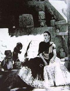 Frida Kahlo in her garden at Casa Azul.