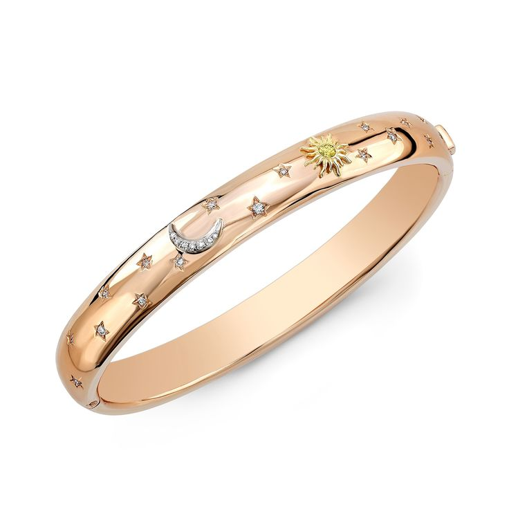Sun Moon and Stars Bangle Bracelet 18K Rose Gold The loveliest members in the cosmos are captured on a sphere of 18K Rose Gold. This striking bangle bracelet is inlaid with full cut white and natural yellow diamonds totaling 55ct. of pure sparkle and wishes come true. Be sure to view the matching ring which would make a perfect surprise gift. Product Details 18K Rose Gold .55ct full cut Vs white and natural diamond  #65allure  #ChristmasGift