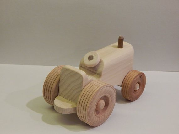 This toy is made out of poplar wood with maple wheels. It is left natural without any paint or stain making it safe for little ones. Dimensions: 5 long 3 wide wheel base 1.5 wide body 3.25 tall.  Please note that the toy contains small pieces.   Thanks for looking at my shop. Please stop back often to see whats new