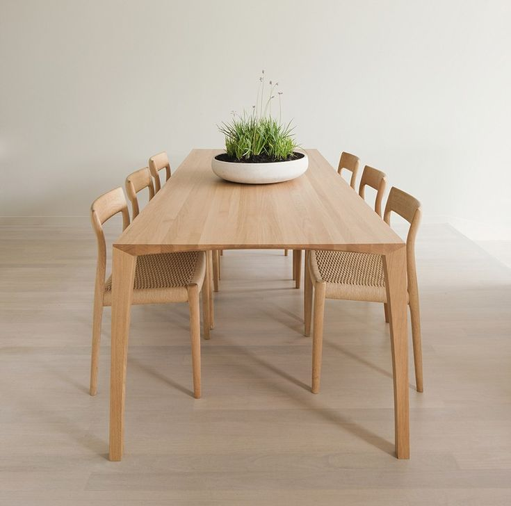 A Light Oak Dining Table Completes The Pared Back Aesthetic Of The Kitchen  Area.