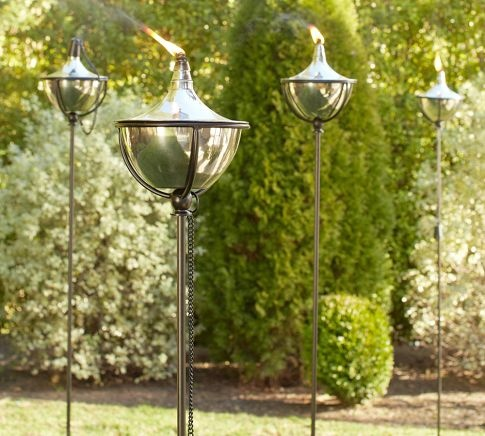 Outdoor Torches - love the iron and stainless steel // these would look great at outside parties