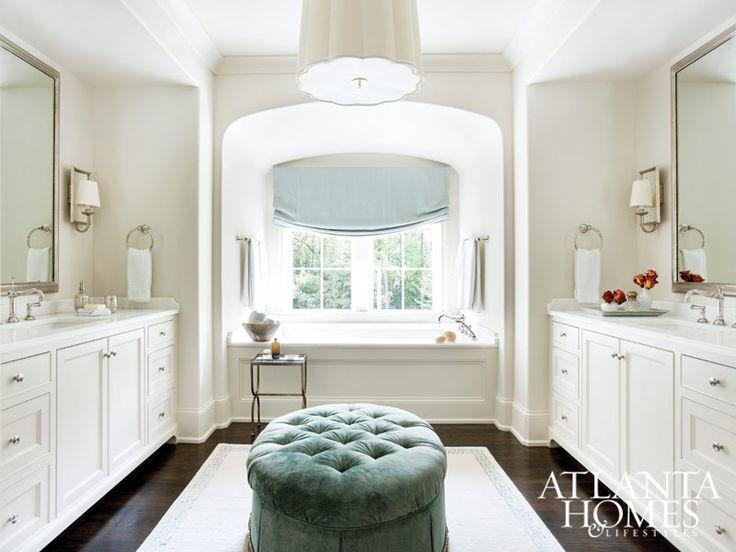 In this bright master bath, a pair of custom mirrors by Myott Studio and dual vanities frame a beautiful built-in tub niche. // Atlanta, GA
