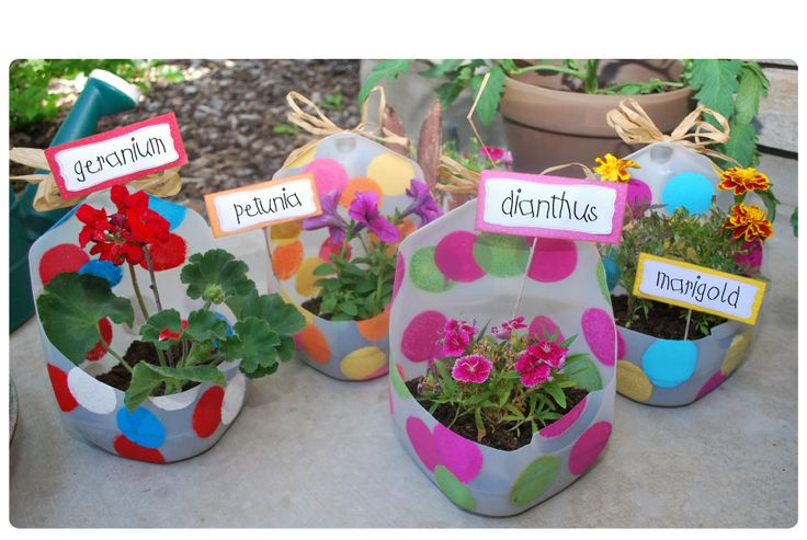 DIY colourful upcycled plastic bottle planters - cut out the top & handle from a large bottle to create a container & encourage children to decorate with paint in fun colours and pick a plant to nurture & grow. Use the homemade planter as an outer cache pot & just rotate smaller pots inside. | The Micro Gardener