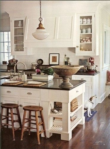 Dark countertops, light cabinets, dark floor. (The complementary counters and flooring make it more cohesive a look)