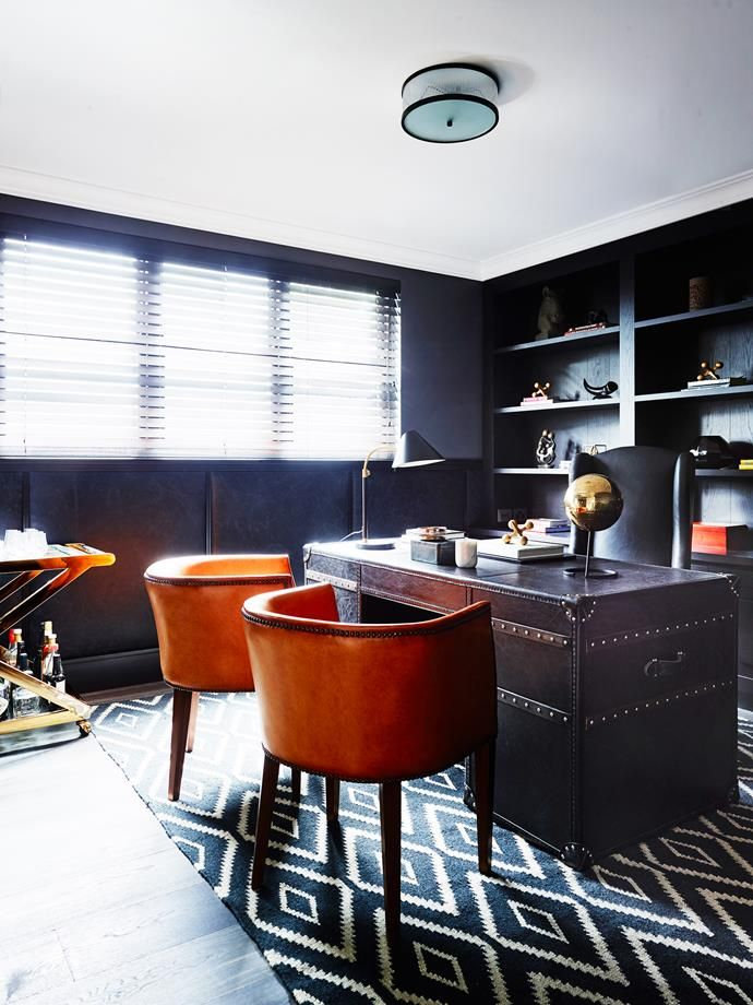 Leather panelled walls and dark timber joinery evoke a masculine mood. Photo: Anson Smart  | Story: Belle