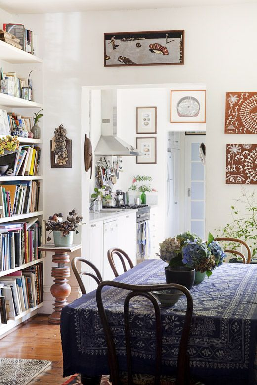 Love the dining area with the books shelves and plants.  Sally Campbell's Sydney home.  Photographs - Felix Forest