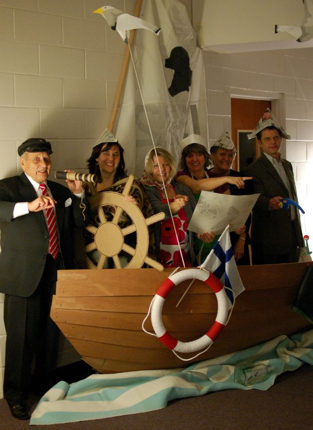 nautical sailor themed party:  to create a 'sailing photo booth'... build a sailboat (or half of one)... set up a sail... offer props such life ring, sailboat steering wheel, map, fishing rod (and boot!), and caps