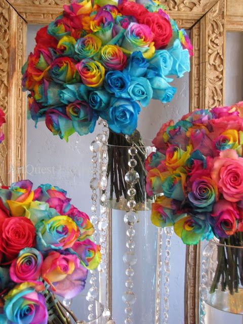 A rainbow of colored roses/ www.volusiacountyweddingflowers/ www.callaraesfloralevents.com