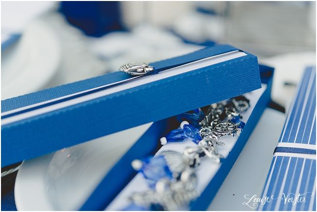 Blue gift favour box with beaded charm bracelet.