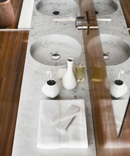 Like the stone top with shallow basin made from same slab. Like the wall mount faucet. Do not like hardware or floor.