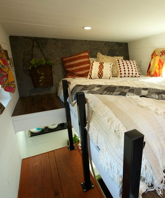"""The 200-square-foot Schooner has a built-in desk/media center, two large bedroom lofts, and a U-shaped kitchen with 24"""" refrigerator/freezer and washer/dryer combo."""