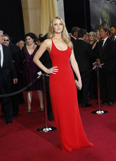 All the celebs are wearing red dresses! Check out this stunning number that Jennifer Lawrence is wearing.