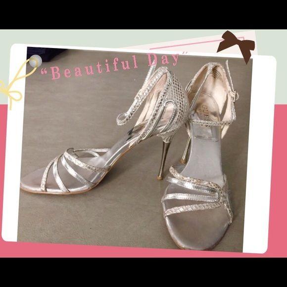 "Guess by Marciano Silver metallic dress shoe Guess by Marciano silver metallic dress shoe:  Shoe Size: 6-1/2,  Heel height: 3-3/4"".  Non- metallic heel part is metal. Great dressy shoe!!! Guess by Marciano Shoes Heels"