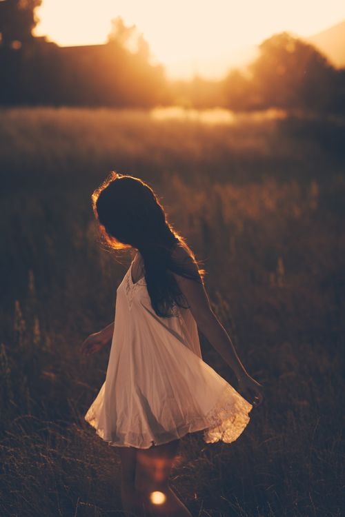 She danced in the sunlight like a butterfly in the air. Every part of her body was shaking in the rhythm of the life.