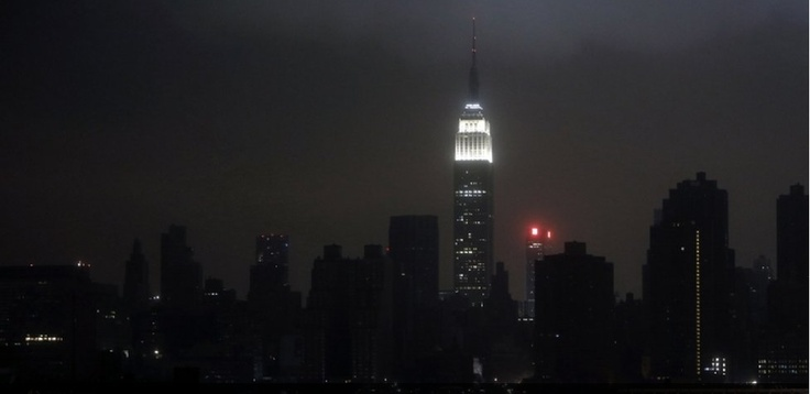 Tropical Storm Sandy came ashore in New Jersey at 20:00 local on Monday, causing widespread flooding and knocking out power to more than six million people, including much of Lower Manhattan in New York.