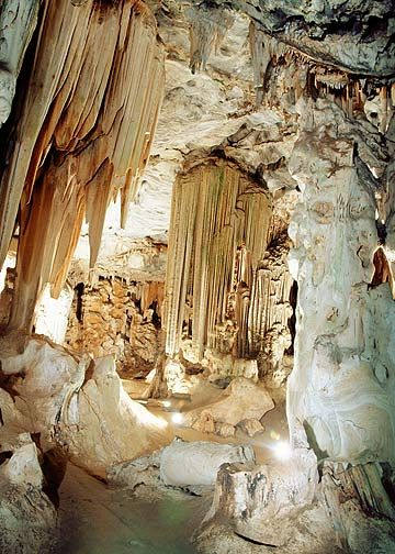 The Cango Caves is a cultural & natural landmark in South Africa. The 20 million year-old Caves system consists of a series of hidden chambers cut deep into a thick limestone rock layer. Situated in the Swartberg Mountains, Oudtshoorn, Western Cape Province. Inhabited since the Early Stone Age, South Africa's oldest tourist attraction, the formations are unique: they would not have normally formed in this area & are a result of faulting.