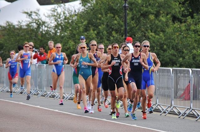 The London 2012 Olympic Women's Triathlon in Hyde Park. The leading pack during the running stage, with Helen Jenkins (GBR) in front and eventual gold-medalist Nicola Spirig (SUI) and silver-medalist Lisa Norden (SWE) in tow.    For more info on the re Fit athletes See Usain Bolt 100m video http://www.joggingtoloseweight.org/olympics-star-usain-bolt/