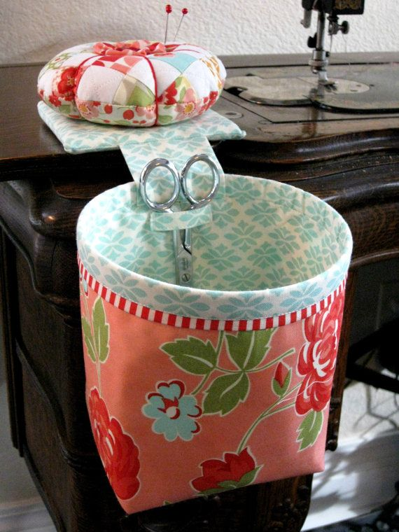 I really like this one--real pincushion, scissor holder, sturdy...(by CurryBungalow at Etsy)