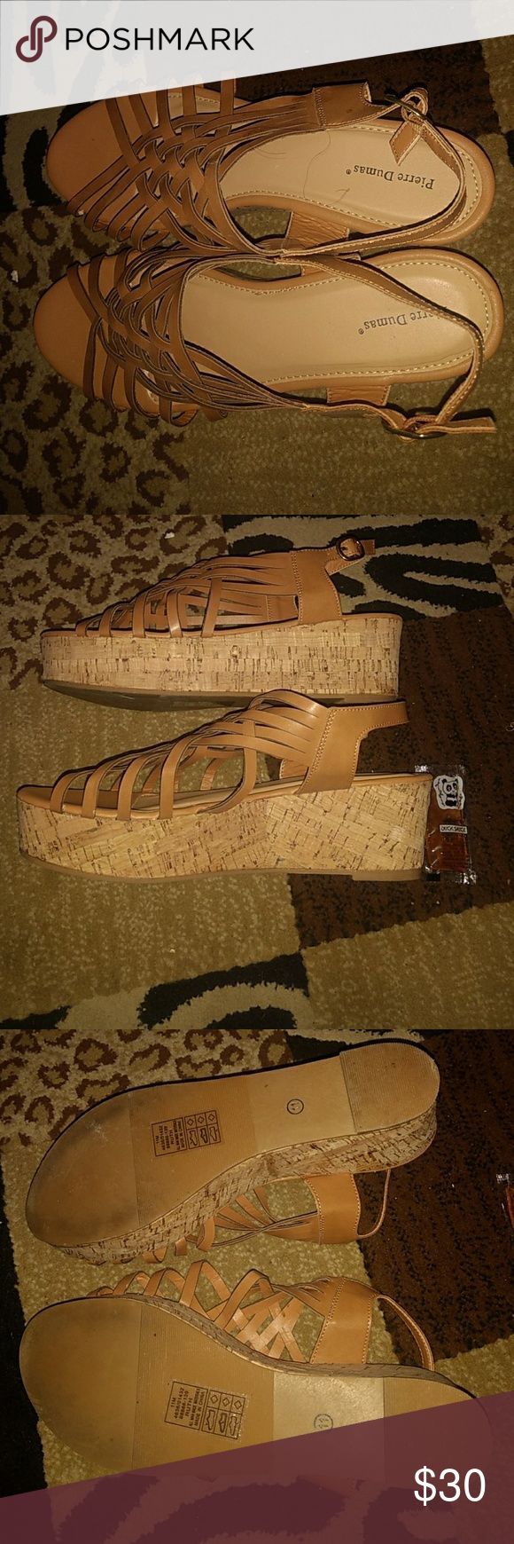 Tan wedge sandals Strappy cork wedge sandals. Worn in home one time. They were too big for me. I've recently gone down in shoe size due to weight loss. Crazy, right? These are heavy in my opinion but if they fit right they probably won't be. I pictured a spot that might be a flaw but idk. Could just be from wearing one time. No box for this pair. Must have tossed it. Pierre Dumas Shoes Sandals