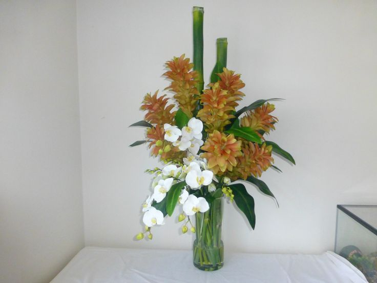 Ginger flowers and Phalaenopsis orchids by Floral Instinct