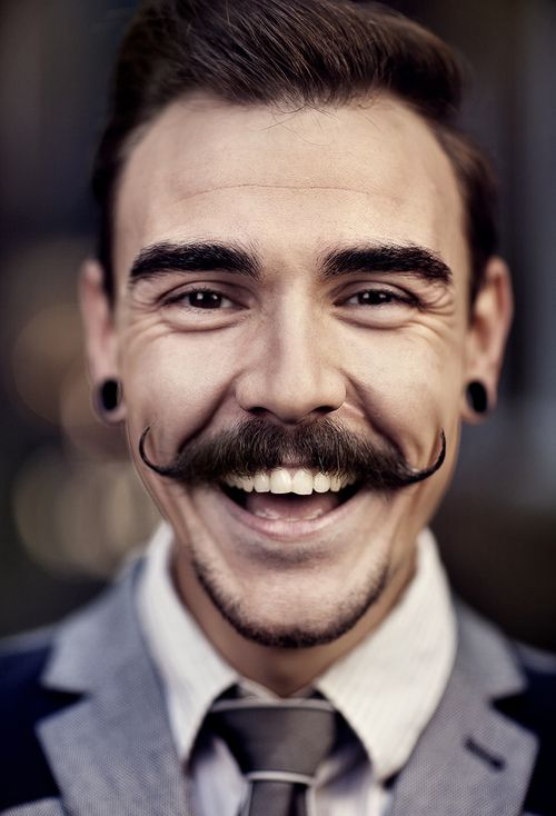 He smiles (not to mention that magnificent moustache!)!!