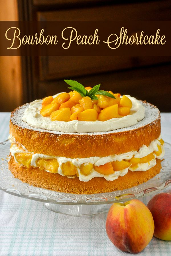 Bourbon Peach Shortcake - a light as air sponge cake gets layered with vanilla whipped cream and peaches which have been marinated in vanilla and bourbon. This