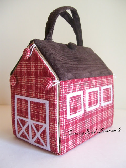 DIY Barn. Great tutorial on making this traveling barn filled with farm animals and such.  There is also a doll house using this same pattern.  I think it would be cute to made as a car shop with little cars inside. One side rolls down flat, could sew road for the cars.  Very cute Idea.