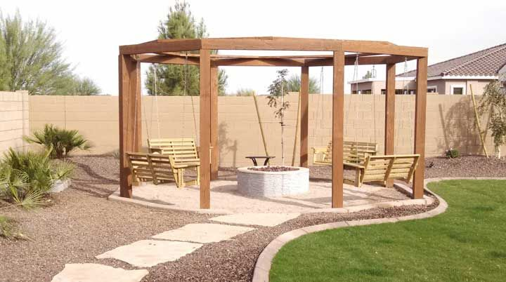 Gas Fire pit with a gazebo with swings.  Az Living Landscape & Design 480-390-4477