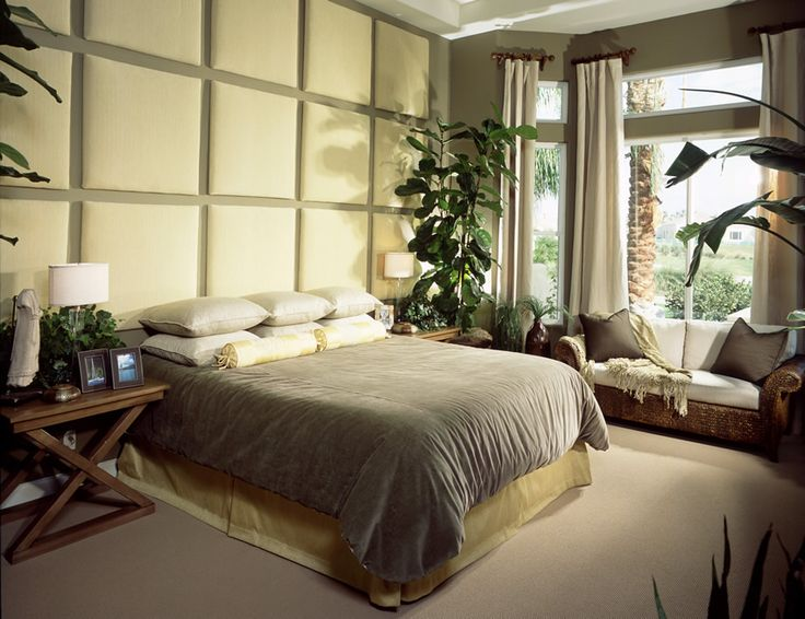 Cozy bedroom with upholstered accent wall
