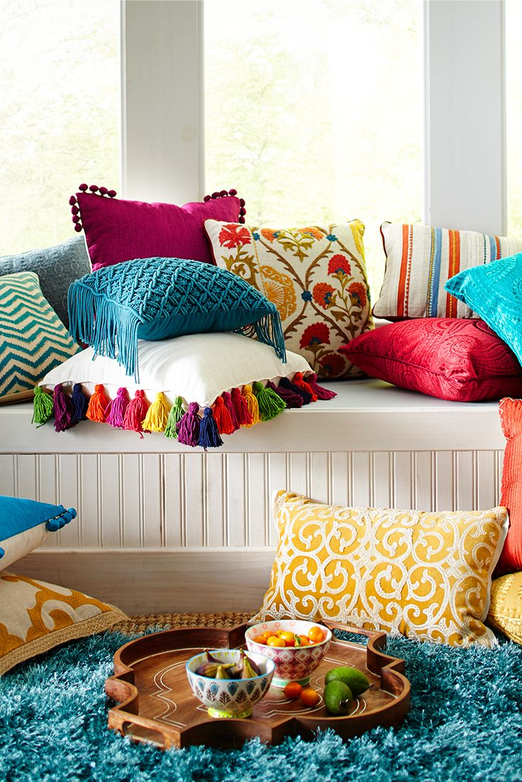 easy way to get the instant boho feel: Mix and match vibrant colors and  intricate patterns with a smattering of pillows in your reading nook.