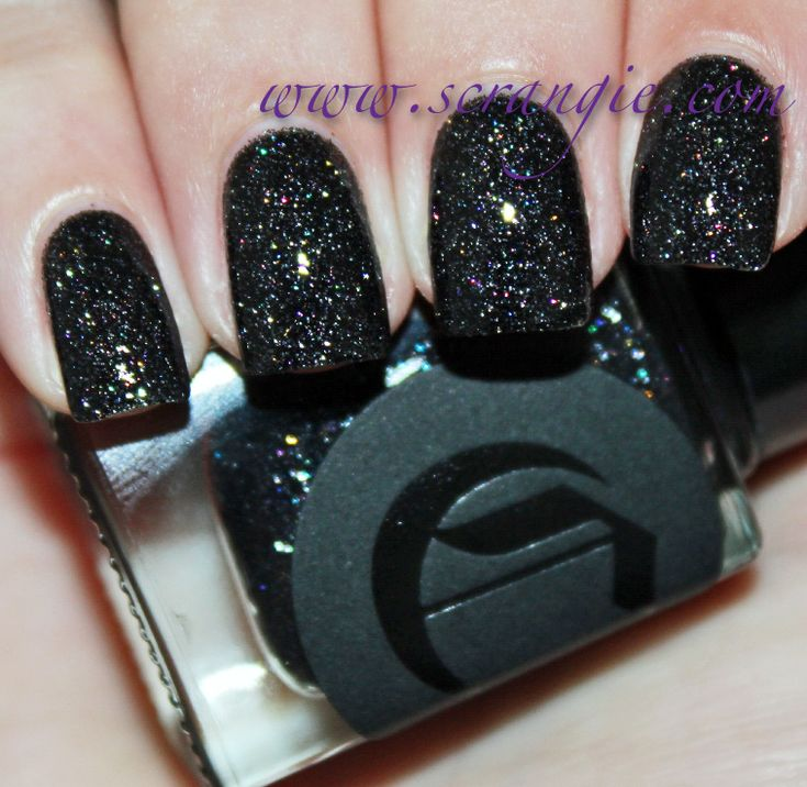Cirque Dark Horse. This is a clear base packed with microglitter. The main color is black- yes, black!- microglitter, but it's accented with a rainbow of other colors. I don't think it's actually holographic like it appears, I think there's actually rainbow glitter in here. It reminds me of Tahitian moon sand, or crushed coal and diamonds.