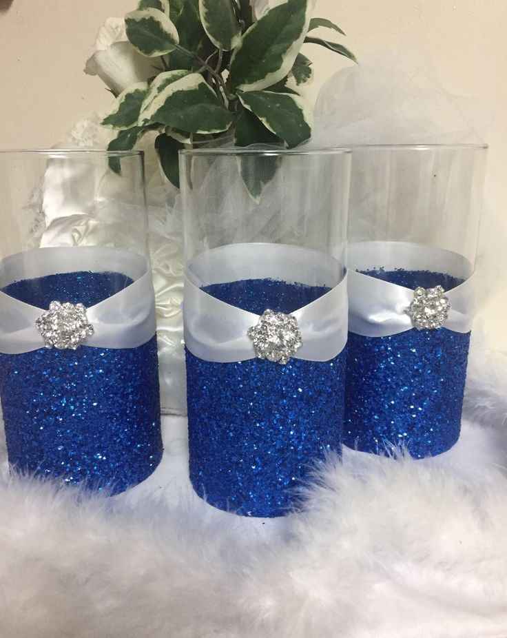 Wedding centerpiece, glitter vase, bridal bouquet holder, bridesmaid bouquet holder, bling wedding, royal blue wedding, candle holder by TheSparkleBooth on Etsy https://www.etsy.com/listing/235423254/wedding-centerpiece-glitter-vase-bridal